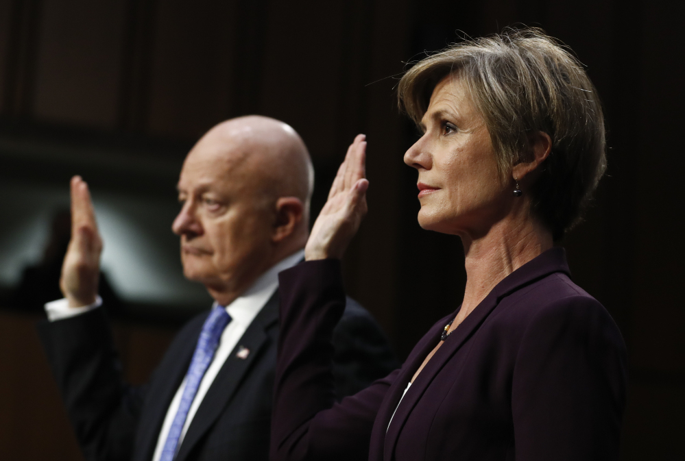 Former acting attorney general Sally Yates and former National Intelligence Director James Clapper are sworn-in on Capitol Hill in Washington on Monday, prior to testifying before the Senate Judiciary subcommittee on crime and terrorism hearing: