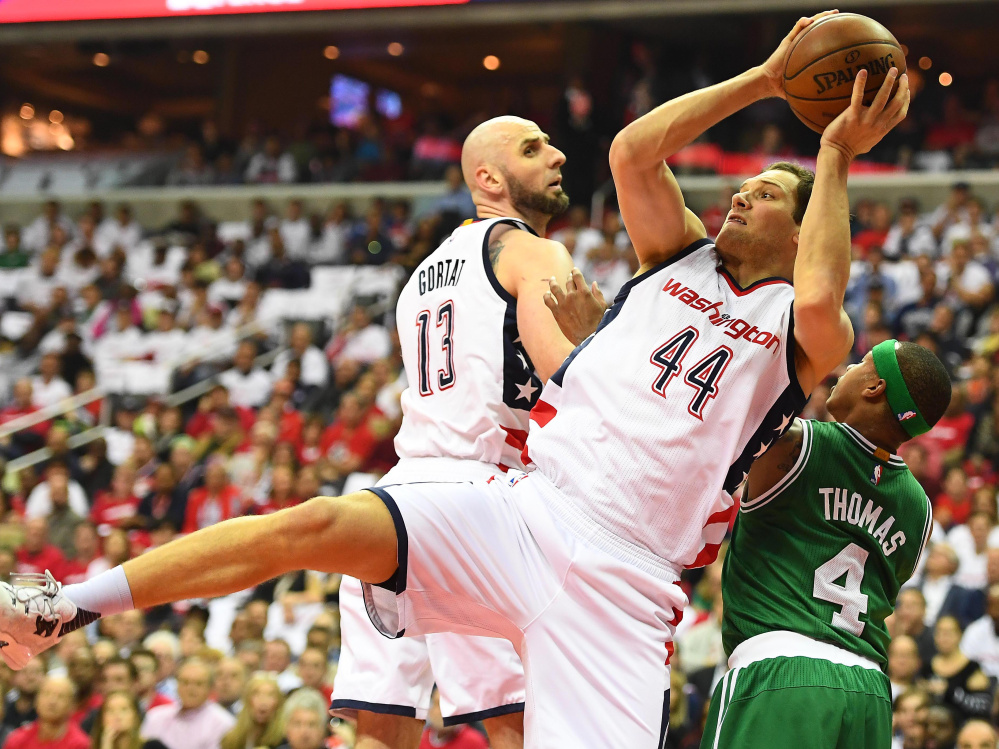 Wizards guard Bojan Bogdanovic grabs a rebound over Celtics guard Isaiah Thomas on Sunday in Washington's 121-102 win in Game 4 to even their second-round series at 2-2.