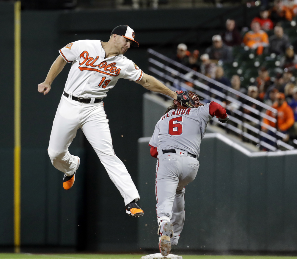 Orioles first baseman Chris Davis tags out Washington's Anthony Rendon after a wide throw on a ground ball in the sixth inning of Baltimore's 6-4 win Monday night in Baltimore. It was the Orioles' fifth straight win.
