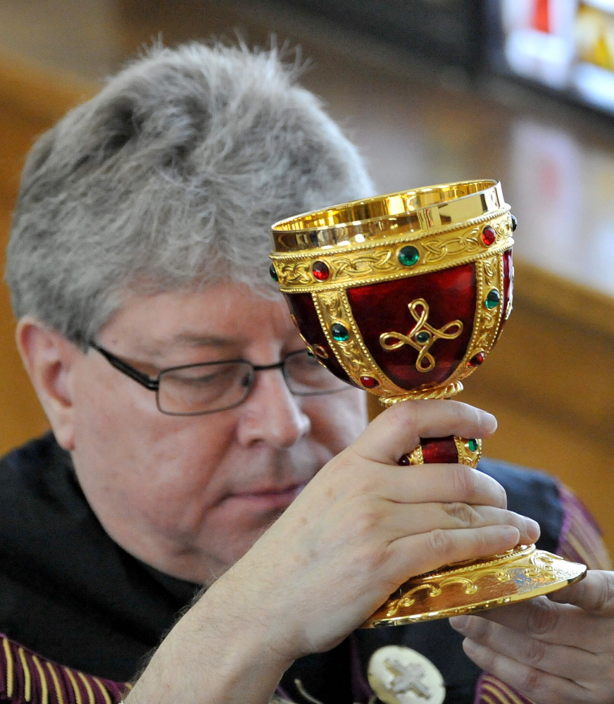 The Rev. Larry Jensen carries the Holy Chalice to the altar during the Signing of the Chalice ritual April 14 at St. Joseph's Maronite Church on Appleton Street in Waterville.