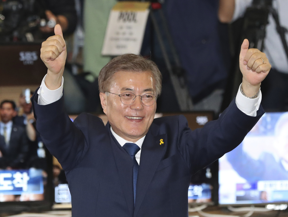 South Korea's  new president Moon Jae-in of the Democratic Party celebrates on Tuesday. Associated Press/ Lee Jin-man