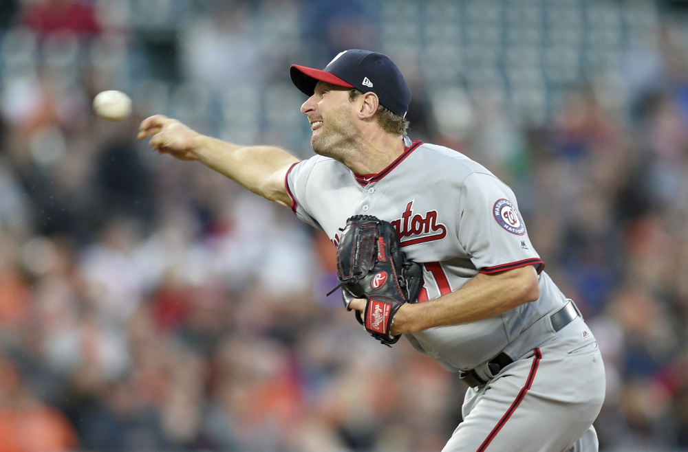 Washington's Max Scherzer delivers a pitch in the third inning Tuesday night in Baltimore. The Orioles won 5-4 in 12 innings.