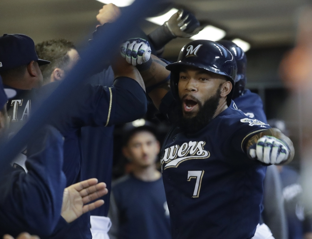 Milwaukee Brewers' Eric Thames celebrates his two-run home run with teammates during the first inning Tuesday against the Boston Red Sox.