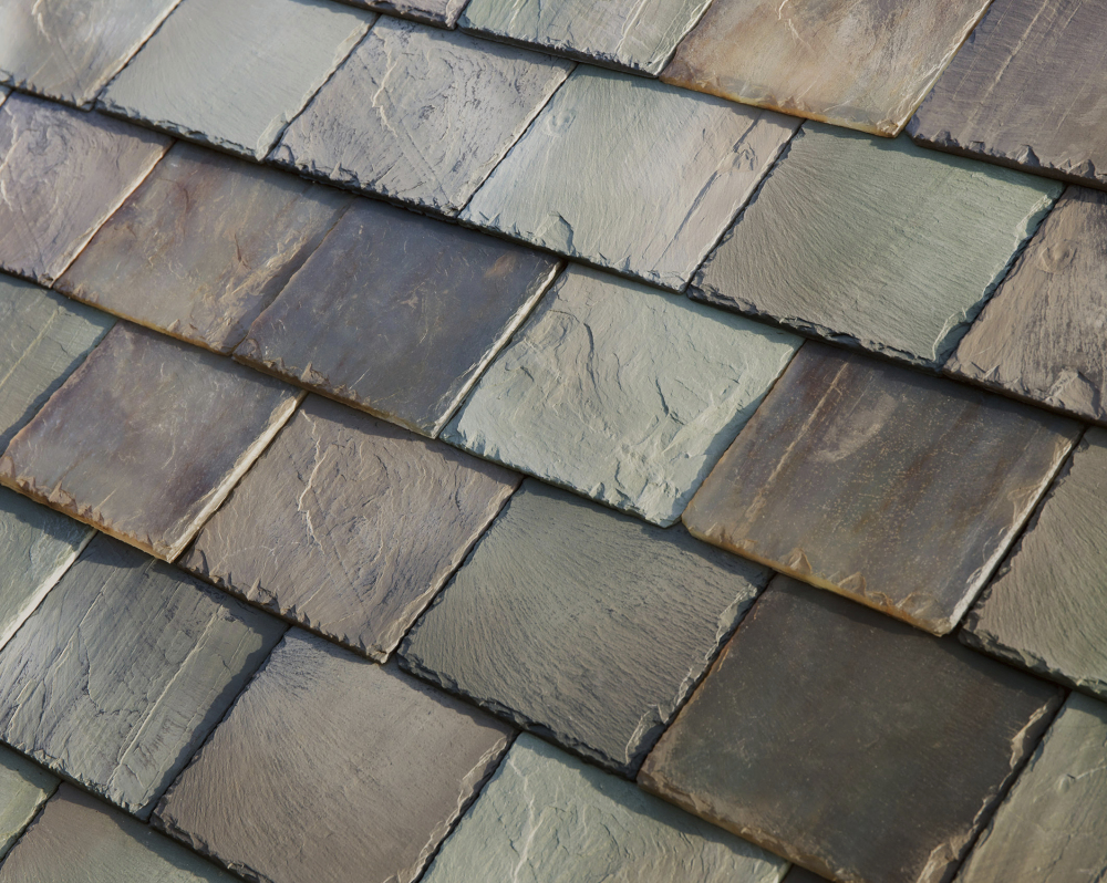 Tesla's glass solar tiles replicate slate, left, or terracotta roofing and are designed to look like a traditional roof. The tiles are guaranteed for the life of a home, much longer than the 20-year lifespan of a typical roof.