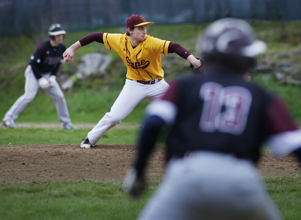 Cape Elizabeth pitcher Sean Agrondia bears down Wednesday with runners at first and third base. Agrondia allowed three hits in five shutout innings as the Capers defeated Freeport, 10-0.