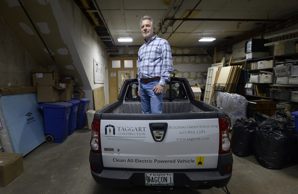 Peter Taggart of Taggart Construction in the back of one of his electric pickup trucks.