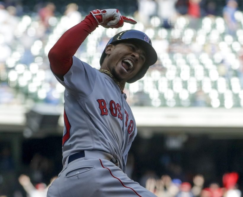 Mookie Betts reacts after hitting a three-run home run in the ninth inning of Thursday's game against the Brewers at Milwaukee.