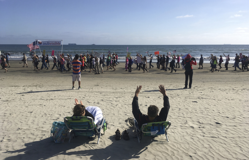 A Republican National Committee spring meeting in Coronado, Calif., last Thursday draws protesters on the beach outside the Hotel del Coronado. For some potential candidates, the Democratic presidential primary for 2020 may have already begun.