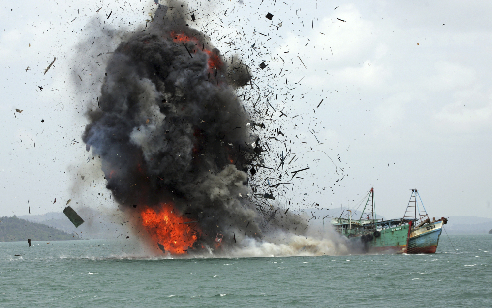 One of hundreds of foreign fishing vessels seized by the Indonesian Navy is destroyed last year off Batam Island, Indonesia. The nation's minister for maritime affairs says such efforts are essential for preserving fisheries.