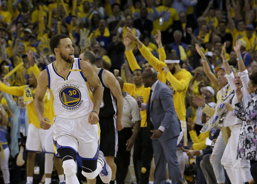 Warriors guard Stephen Curry during Golden State's 113-111 win over San Antonio in Game 1 of the Western Conference finals Sunday in Oakland, California.