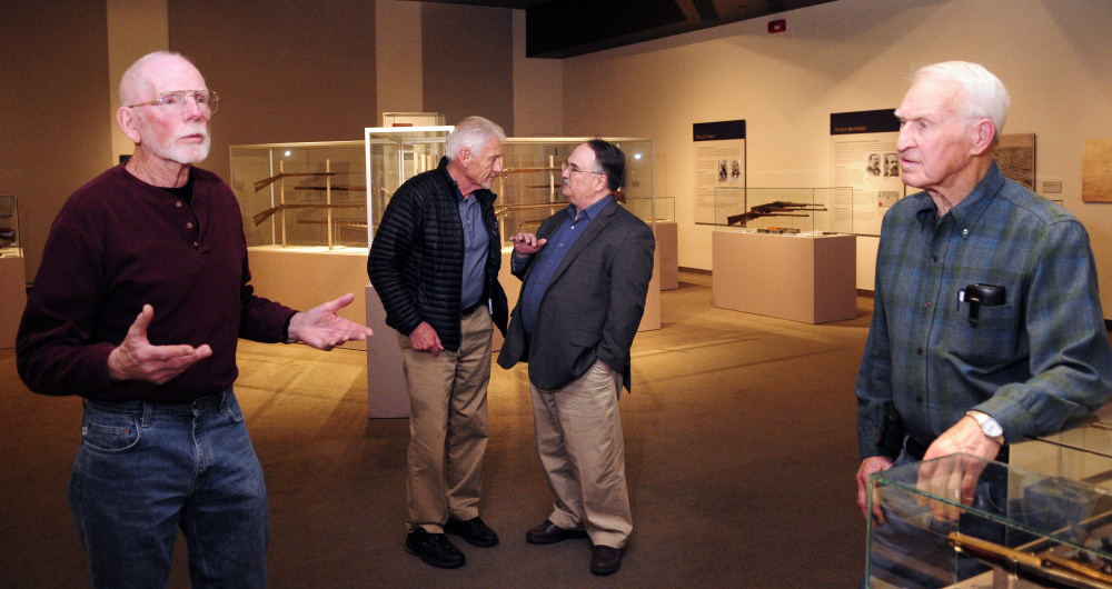 Bob Shelton, 78, left, Paul Wade, 74, Maine State Museum Director Bernard Fishman and Oscar Cronk, 86, chat in a gunsmithing display at the Maine State Museum in Augusta.