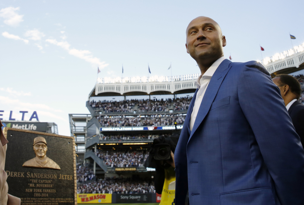 Former New York Yankees shortstop Derek Jeter is honored during a pregame ceremony Sunday at Yankee Stadium in New York. Jeter's No. 2 was retired and a plaque in his honor will be placed in Monument Park at the stadium.