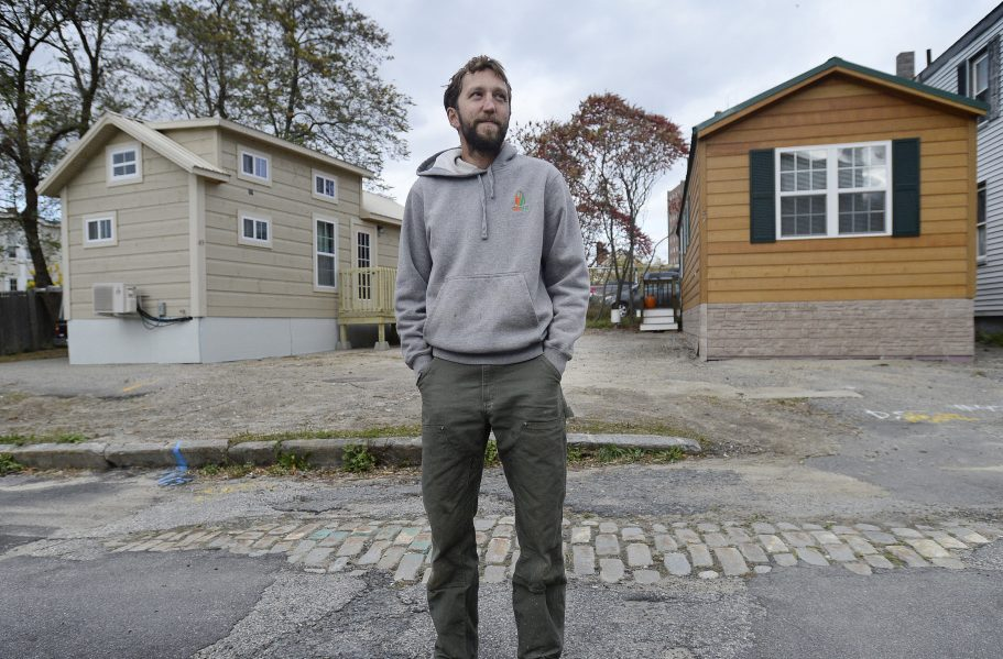 Brent Adler in October with the two tiny houses he placed in the Bayside area without having the required permits. Adler will pay a $1,000 fine and has until July 3 to remove the homes. Staff file photo by Shawn Patrick Ouellette