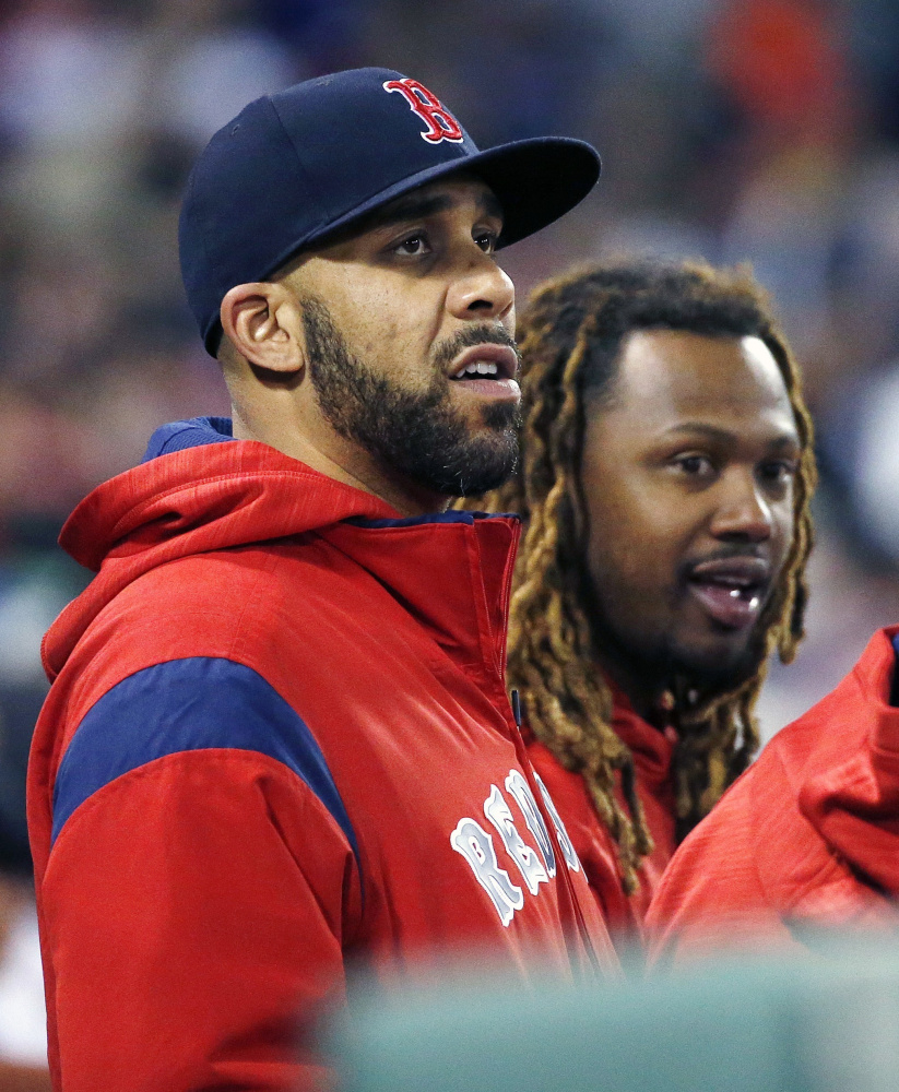 David Price, left, has not pitched and Hanley Ramirez has not been unable to play first base, yet Boston is still within striking distance.
