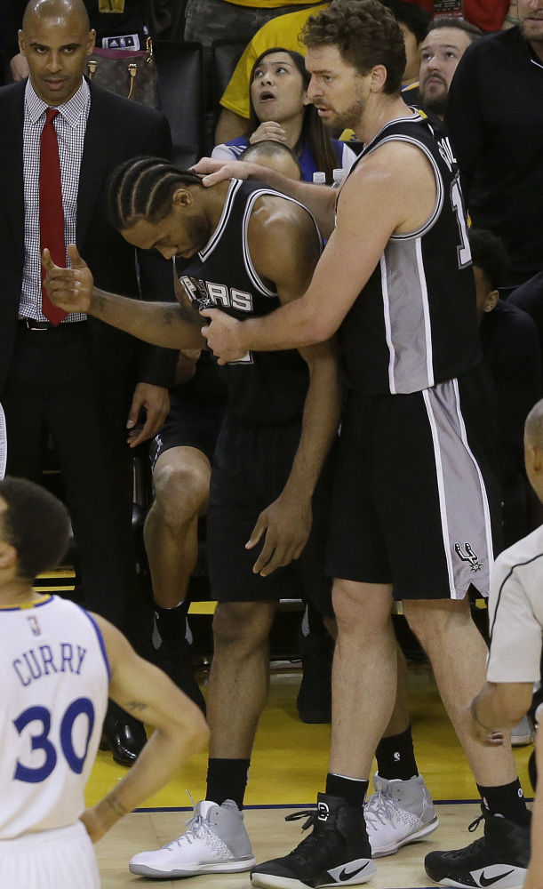 San Antonio forward Kawhi Leonard, center, has been ruled out for Game 2 of the Western Conference finals with an ankle injury.