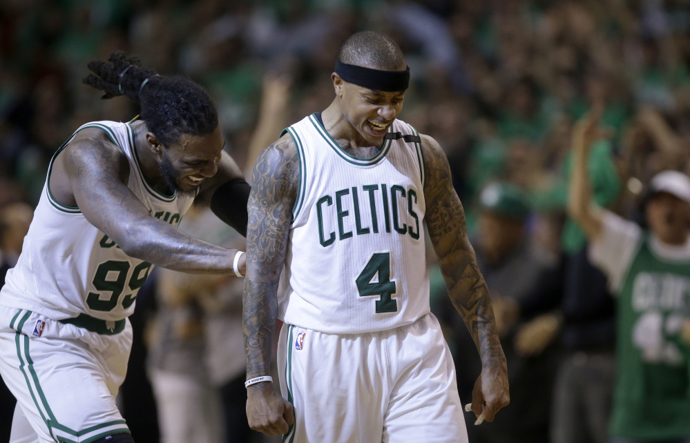 Celtics guard Isaiah Thomas celebrates his basket with Jae Crowder in the fourth quarter of Game 7 Monday night in Boston.