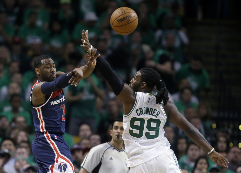 Wizards guard John Wall delivers a pass as Celtics forward Jae Crowder defends in the second quarter of Monday night's game.
