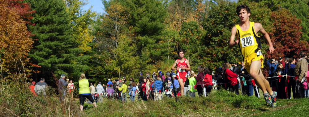 Ruslan Reiter rounds a corner on his way to a third-place finish in the Kennebec Valley Athletics Conference Class B cross country championships in October at Cony High in Augusta.