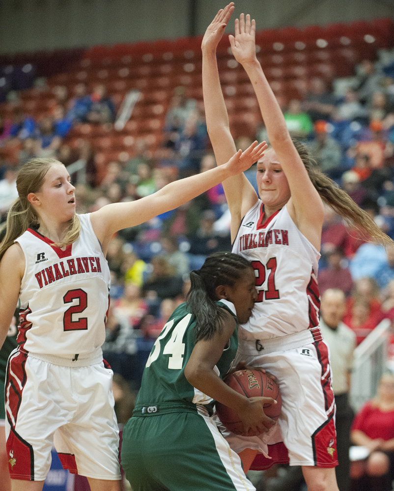 Vinalhaven's Gilleyanne Davis-Oakes, right, and Ashlyn Littlefield helped stop Selam Heinrich and Temple Academy en route to the Class D state championship, the school's first.