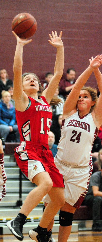 Staff photo by Joe Phelan   Vinalhaven's Deja Doughty, left, shoots as Richmond's Cassidy Harriman defends during a game Friday at Richmond High School.