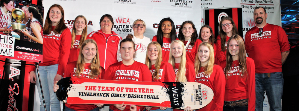 The girls' basketball team from Vinalhaven, Class D state champions, accepts its Team of the Year award at the Varsity Maine Awards.