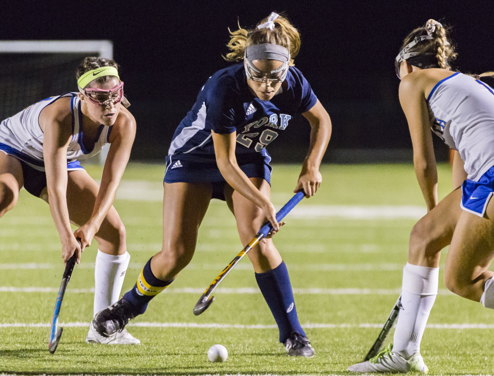 Over her four seasons at York High, Lily Posternak helped the field hockey team compile a 71-1 record and capture three Class B state championships. She was also a starting guard on a successful basketball team.