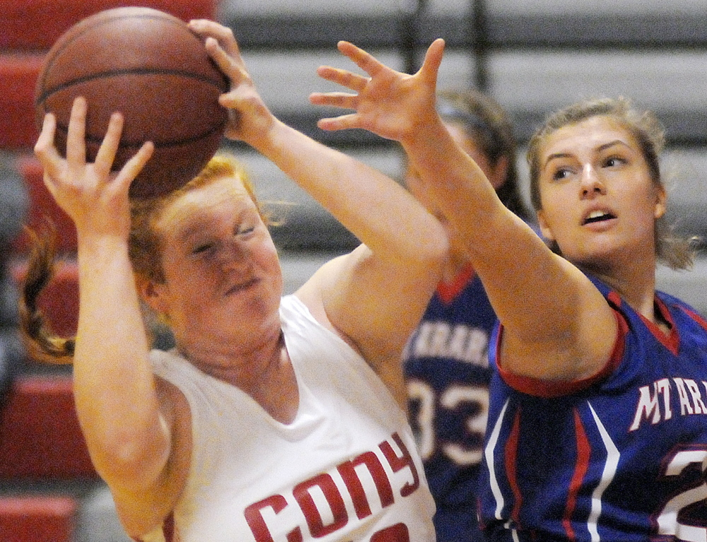 AUGUSTA, ME - JANUARY 28: Cony High School's Rebecca Coniff  grabs a rebound away from Mt. Ararat High School's Kate Guerin during a basketball matchup Wednesday January 28, 2015 in Augusta. (Kennebec Journal photo by Andy Molloy/Staff Photographer)