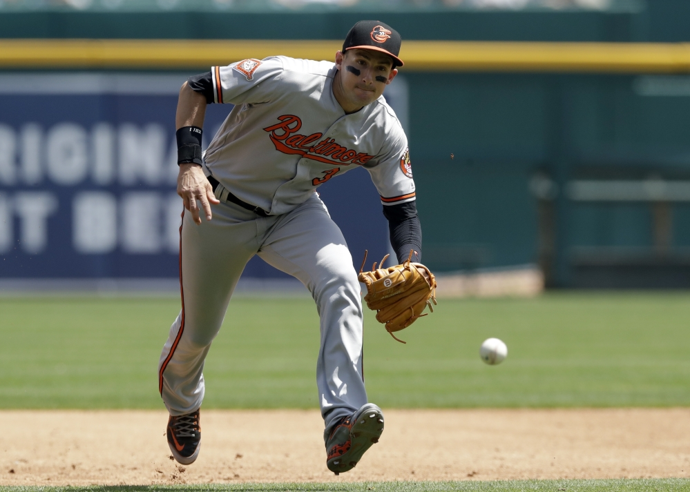 Ryan Flaherty, the Portland native playing third base for the Baltimore Orioles, charges a single hit by Nick Castellanos of the Tigers in Detroit's 6-5 victory Thursday. Flaherty went 1 for 4.