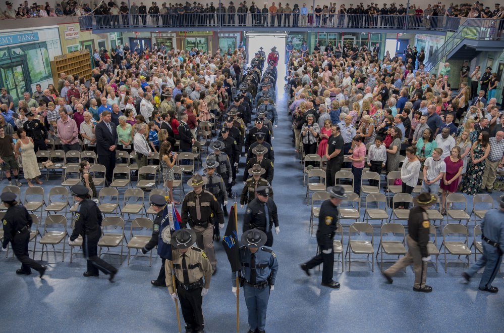 Graduates of the 32nd Basic Law Enforcement Training Program enter the hall at the Maine Criminal Justice Academy in Vassalboro. Fifty-eight officers from across Maine graduated at ceremonies held on Friday.