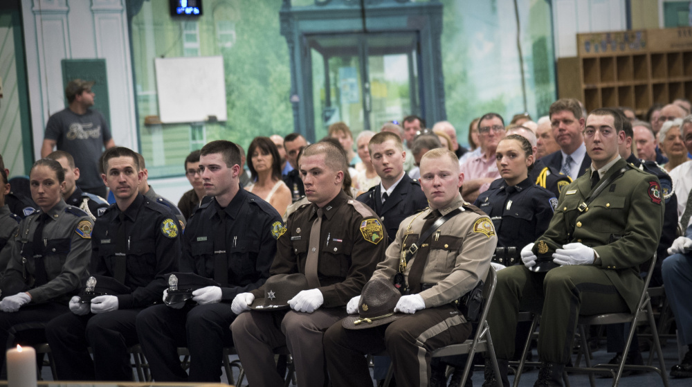 Officer Tyler LaFreniere, of Madison, front row right, sits with his graduating class at the Maine Criminal Justice Academy graduation ceremonies on Friday in Vassalboro. LaFreniere is joining the Somerset County Sheriff's Office.