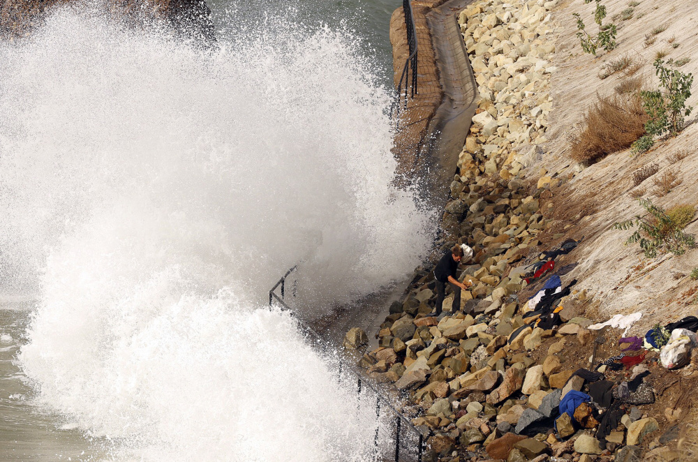 High surf crashes into the sea wall at Will Rogers State Beach in Pacific Palisades. Waves can enhance flooding, scientists say.