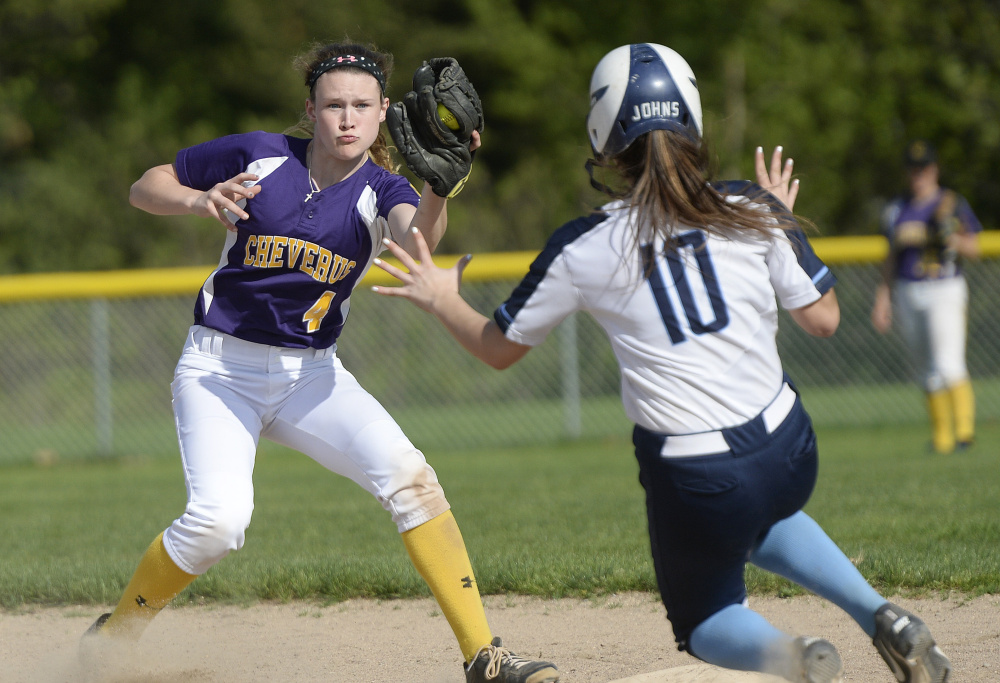 Alex Hammond of Cheverus/North Yarmouth Academy prepares to tag out Angelica Johns of Westbrook, who was caught stealing Friday. Westbrook earned a 15-7 victory at home.