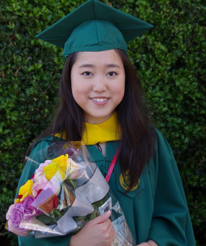 Seventeen-year-old Stephanie Mui celebrates the master's degree she earned at George Mason University's 50th commencement last week.