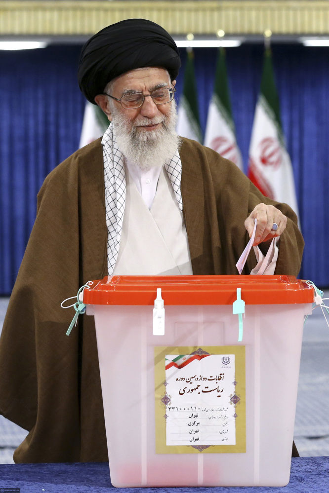 Ayatollah Ali Khamenei casts his ballot in the presidential election in Tehran, Iran, on Friday. Iranians voted in the country's first presidential election since its nuclear deal with world powers, as incumbent Hassan Rouhani faced a staunch challenge from a hard-line opponent over his outreach to the West.