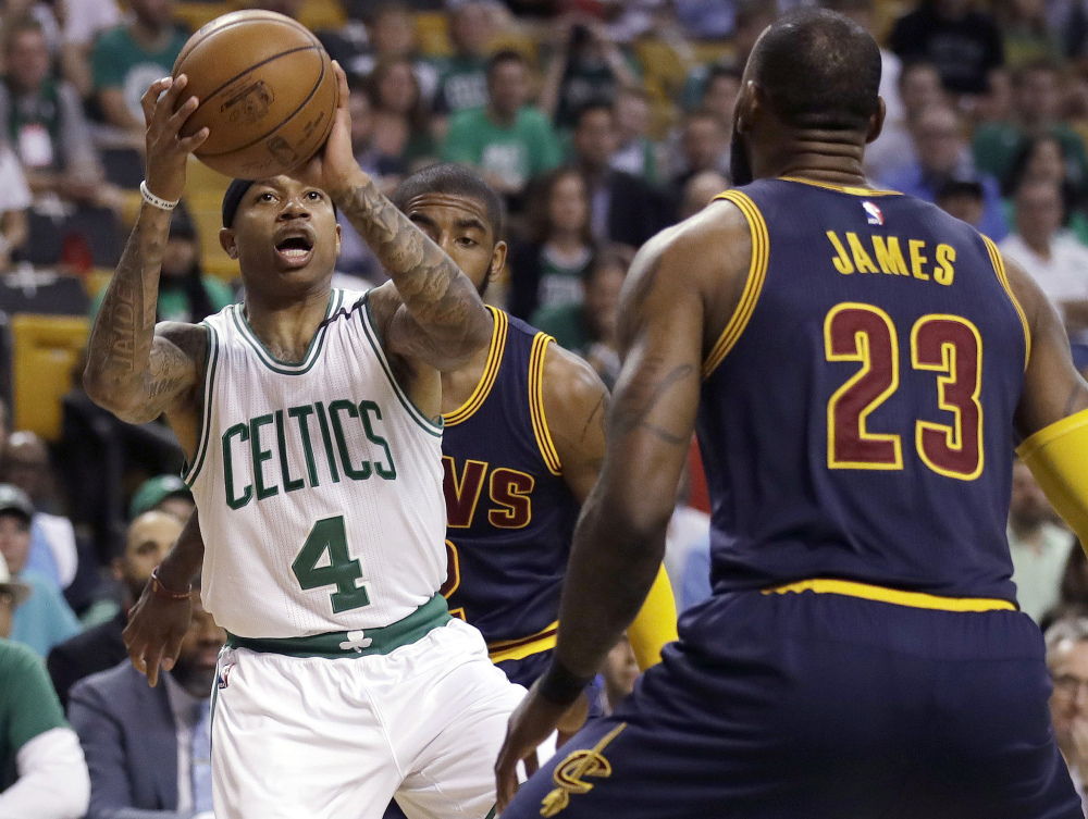 Boston Celtics guard Isaiah Thomas, left, prepares to shoot as Cleveland Cavaliers forward LeBron James during Game 1 of the Eastern Conference finals. In Game 2 Thomas re-injured his hip and will not play the rest of the season. (Associated Press/Charles Krupa)