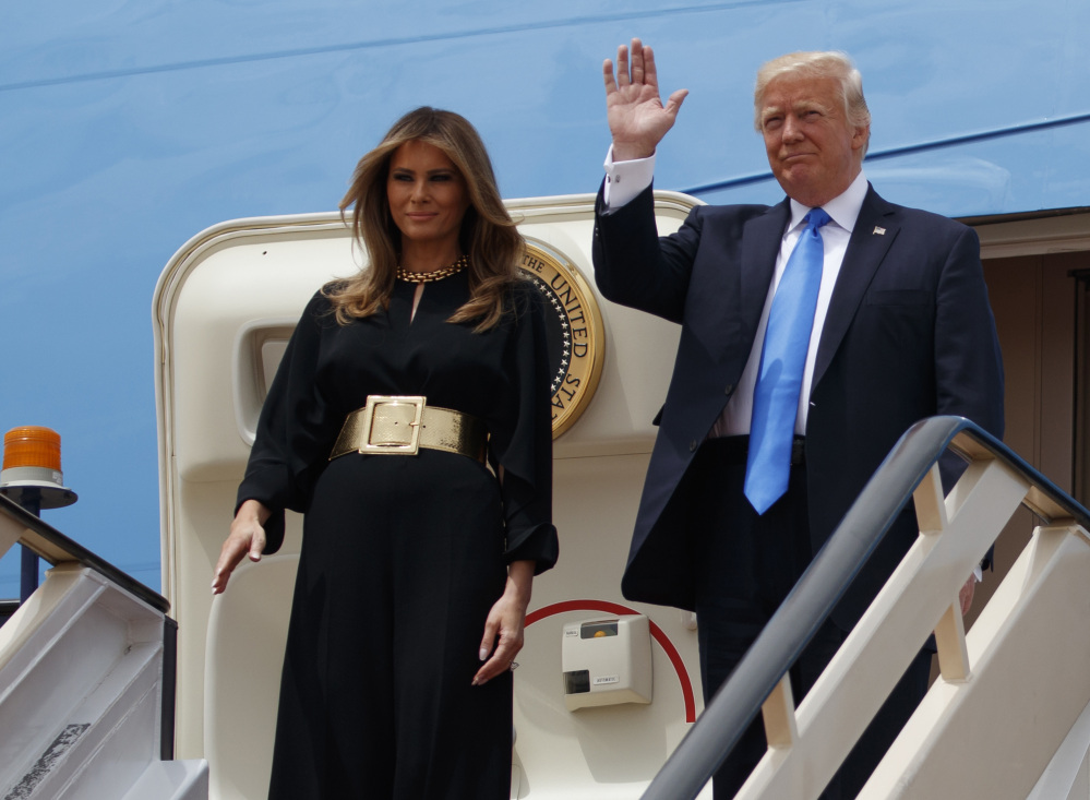 President Trump and first lady Melania arrive for a welcome ceremony at the Royal Terminal of King Khalid International Airport, Saturday. Melania Trump and the president's daughter Ivanka shunned head scarves, though they did dress conservatively, at least by Western standards.