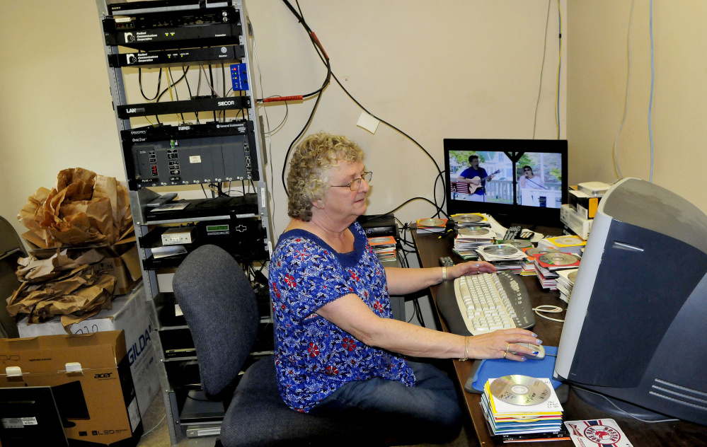 Central Maine Community Access television station manager Laura Guite works in the broadcast room in Fairfield.