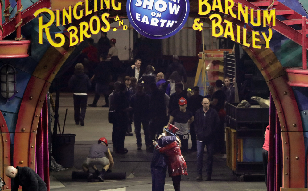 Ringling Bros. ringmaster Kristen Michelle Wilson, center right, hugs a crew member after the final show by one of the circus' two touring units May 7 in Providence, R.I.