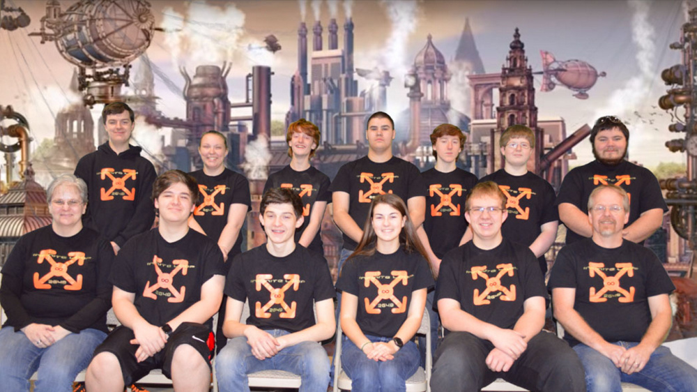 The Infinite Loop team for this school year includes: front row from left, coach Lisa Klein, Michael Viens, Vann Guarnieri, Chelsea Perry, Ethan Pullen and coach Keith McGlauflin; back row from left, mentor Brandon Belanger, Victoria Christianson, Kody King, Delsin Klein, David Hreben, Kai McGlauflin and mentor Justin Shuman.