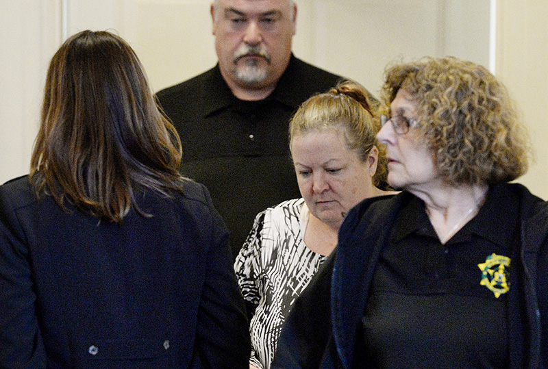 Kandee Weyland, center, is lead into York County Superior Court in Alfred on Thursday.