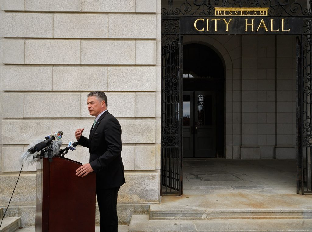Mayor Ethan Strimling holds a news conference outside Portland City Hall on Monday to announce the creation of a task force to study the city's charter. Strimling says the task force's interpretation of the charter could help smooth the contention that has developed between him, City Manager Jon Jennings and the City Council members.