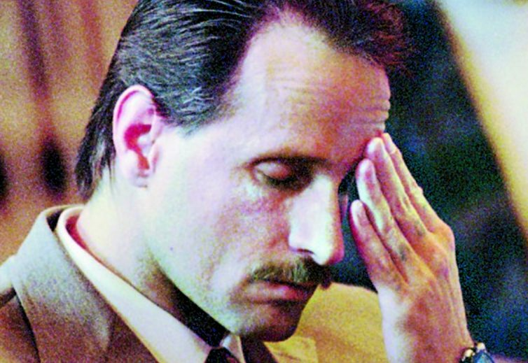 Robert Wayne Lonardo wipes his forehead Oct. 31, 1995, while listening to closing arguments in his murder trial at Lincoln County Superior Court in Wiscasset. Lonardo was found guilty in the murder of Marianne Pembroke during a botched July 21, 1994, burglary of her home in Waterville. Lonardo is seeking a postconviction review, arguing a plea bargain was not communicated to him properly.