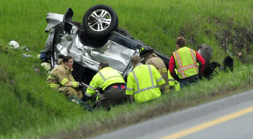Firefighters and rescue personnel work at the scene of the crash in Benton.