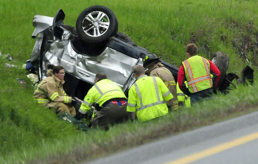 Firefighters and rescue personnel extricate the occupant of this vehicle that went off the northbound lane of I-95 in Benton and went airborne before rolling over three times on Monday. Mary Ricci of Portland was pronounced dead at the scene.
