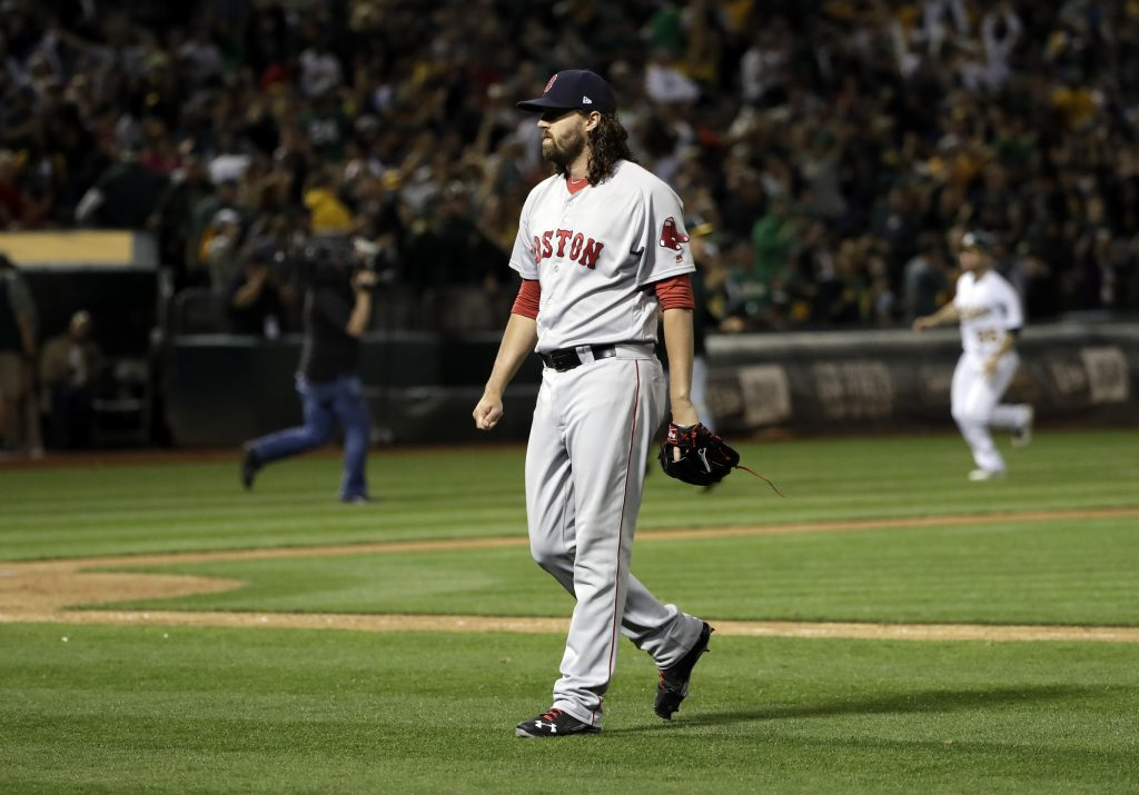 Red Sox relief pitcher Heath Hembree walks off the field after giving up a solo walk-off home run to the Oakland Athletics' Mark Canha during the 10th inning on Friday.