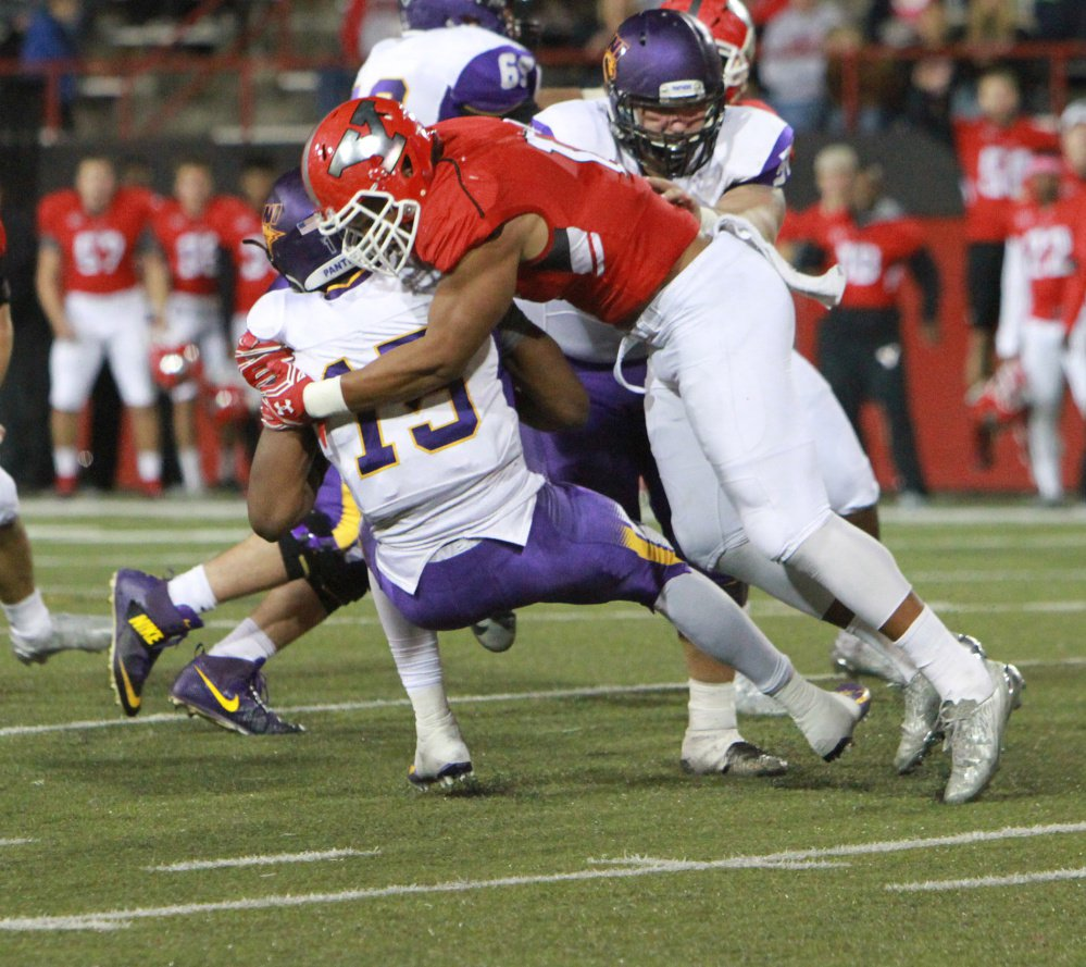 Derek Rivers, right, wraps up Northern Iowa quarterback Aaron Bailey during a game last season.
