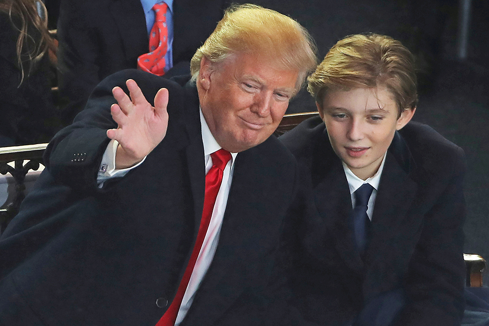 President Trump and his son Barron attend the Inaugural Parade in Washington on Jan. 20, 2017.