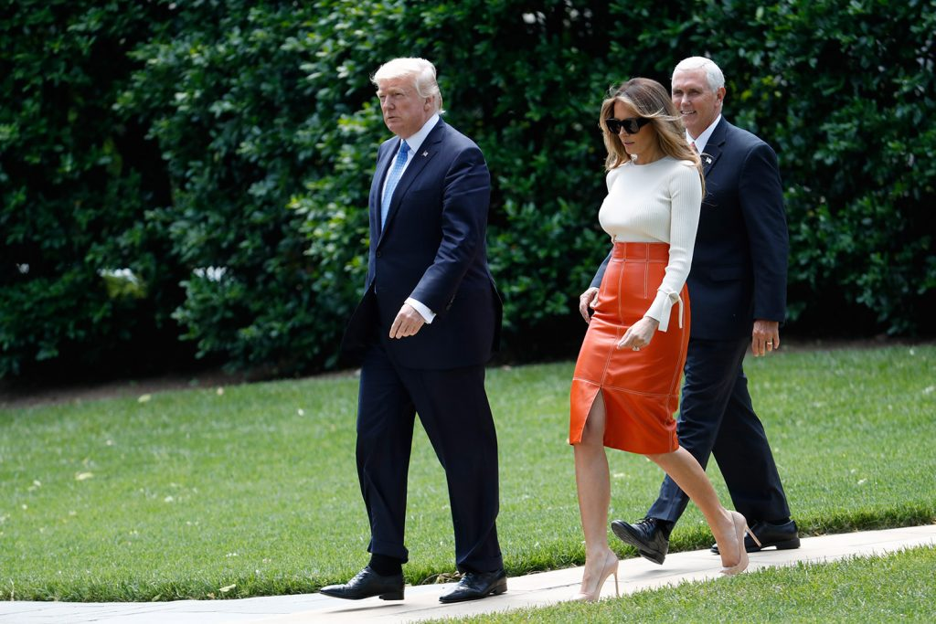 President Trump and first lady Melania Trump, escorted by Vice President Mike Pence, walk across the South Lawn of the White House in Washington on Friday before boarding Marine One for a short trip to Andrews Air Force Base, Md. Trump is leaving for his first foreign trip, visiting Saudi Arabia, Israel and the Vatican, and attending a pair of summits in Brussels and Sicily.