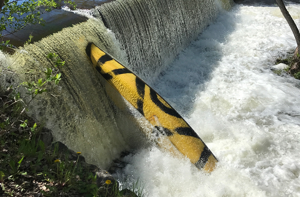 This is the canoe that Maine game wardens say tipped over in Outlet Stream in Vassalboro on Monday evening, resulting in the death of 5-year-old William Egold. The canoe was still caught in falls on the stream Tuesday morning.