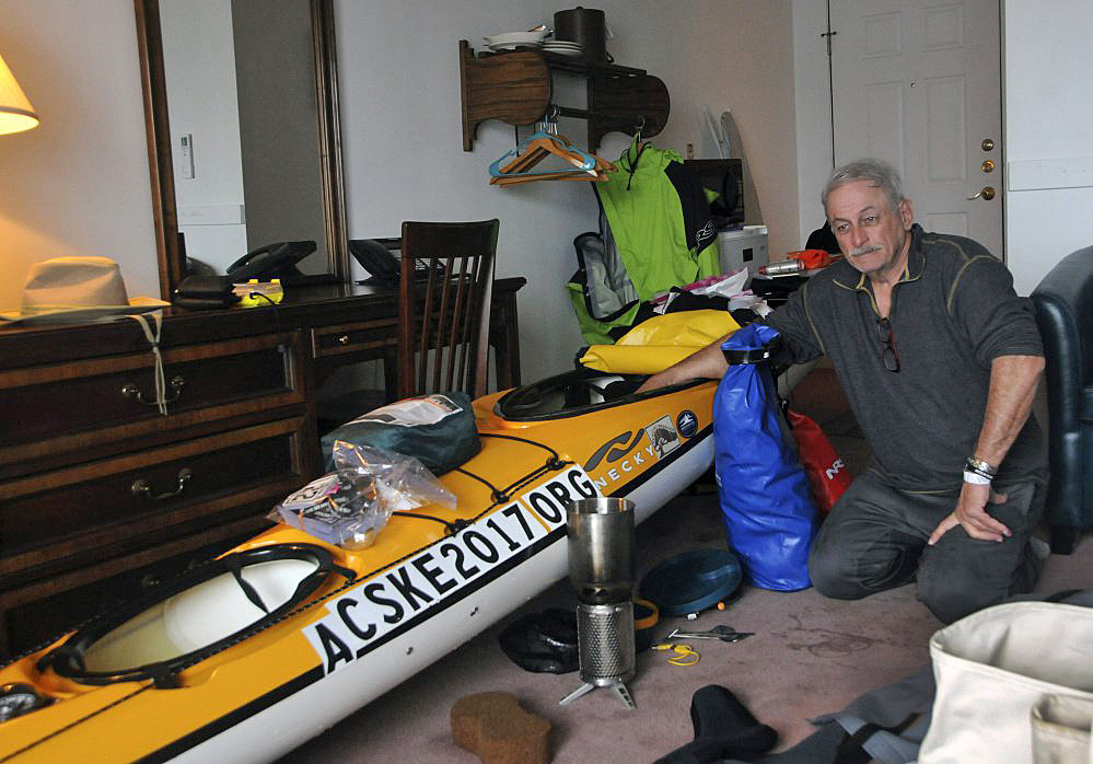 Joseph Mullin sits in his room Monday at the Motel East in Eastport with his sea kayak. Mullin's kayak flipped Sunday off Down East Maine and he had to be rescued by the Coast Guard. He plans to paddle down the East Coast to Key West, Fla., to raise money and awareness for efforts to prevent suicide by veterans.